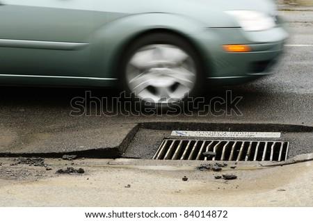 Asphalt uplifting following  a 12 inch water main failure on Harvard Ave in Roseburg OR - stock photo