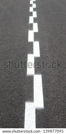 Asphalt with two white dashed lines