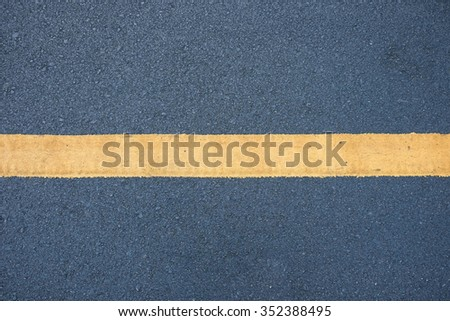 asphalt with yellow stripe - stock photo