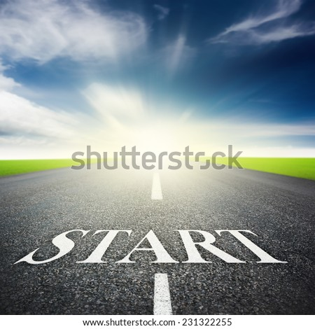 asphalted highway over blue sky with white start word background - stock photo