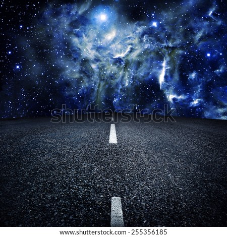 asphalted highway over night sky with stars background. Elements of this image furnished by NASA - stock photo