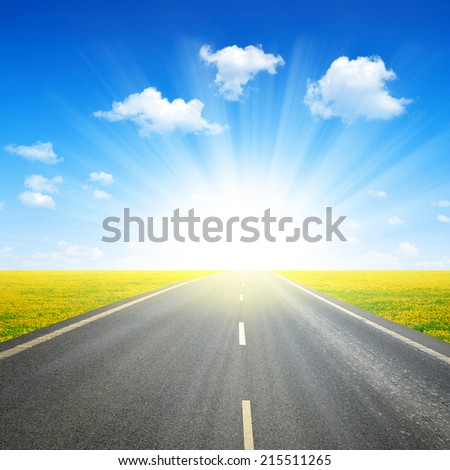 Asphalted road and sunny sky
