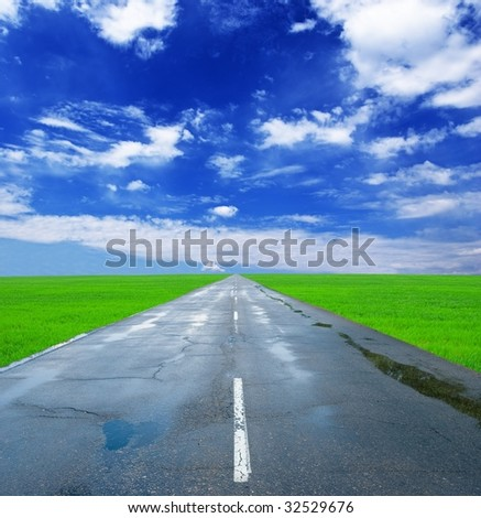 asphaltic road after a rain - stock photo