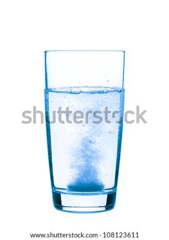 Aspirin in a glass closeup, healthy concept - stock photo