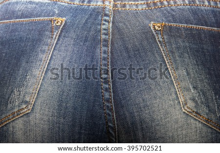 ass beautiful women in tight jeans, women's buttocks in blue jeans close-up, soft focus - stock photo