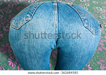 Ass girl dressed in jeans. very sexy ass. very sexy ass. XXX - stock photo