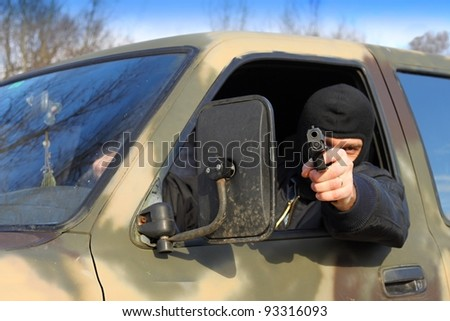assassin shooting from a moving car