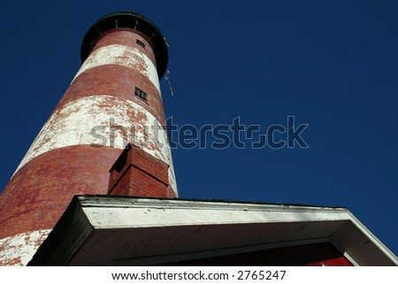 Assateague Lighthouse with bright blue sky - stock photo