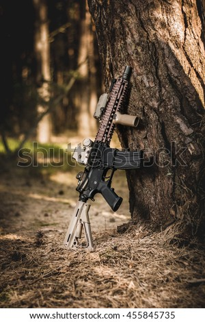 assault rifle in the forest - stock photo