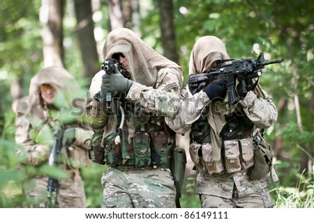 assault team in forest - stock photo