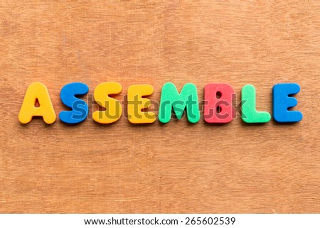 assemble colorful word on the wooden background - stock photo