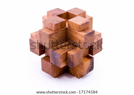 Assembled 24 piece burr puzzle in wood on white background - stock photo