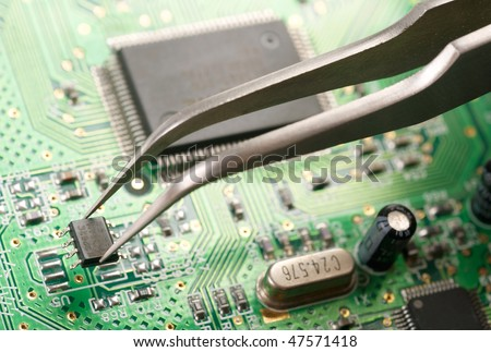 Assembling a circuit board - stock photo