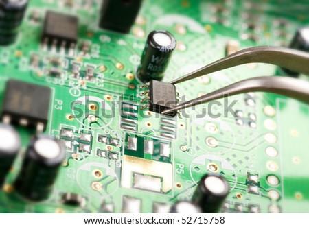 Assembling a circuit board - stock photo
