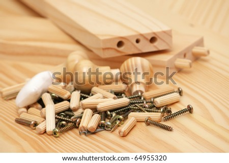 Assembling wooden furniture, many screws and nails - stock photo