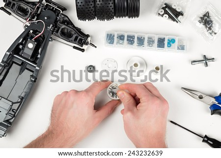 assembly of a rc car gear box - stock photo