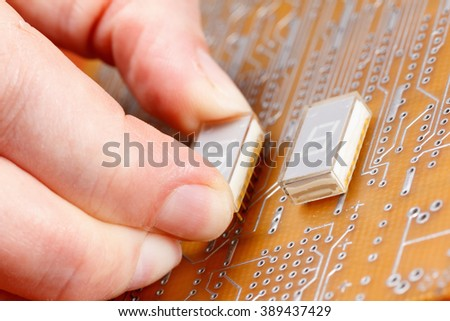 Assembly of electronic components on a printed circuit board - stock photo