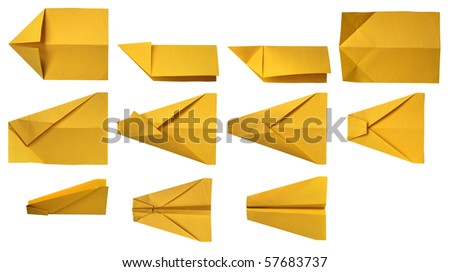 assembly procedure of paper plane - stock photo