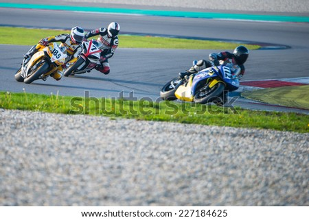 ASSEN, NETHERLANDS - OCTOBER 19, 2014: Competitors racing through the apex of the 1000cc superbike races on the TT Assen circuit - stock photo