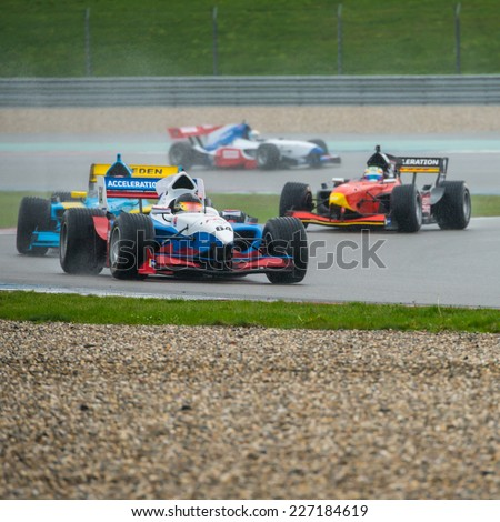 ASSEN, NETHERLANDS - OCTOBER 19, 2014: Formula FA1 cars druing the warm up lap of the final wet race of the Acceleration 2014 tour - stock photo