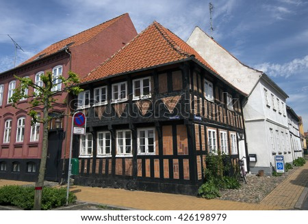 ASSENS, DENMARK - MAY 22: Old vintage style Danish house with summer clear blue sky. May, 22 2016 Assens, Funen, Denmark. - stock photo