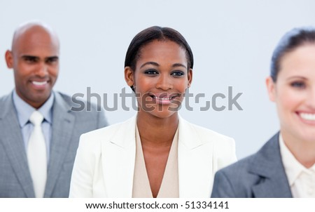 Assertive business team  against a grey background