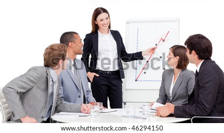 Assertive businesswoman giving a presentation to her colleagues - stock photo