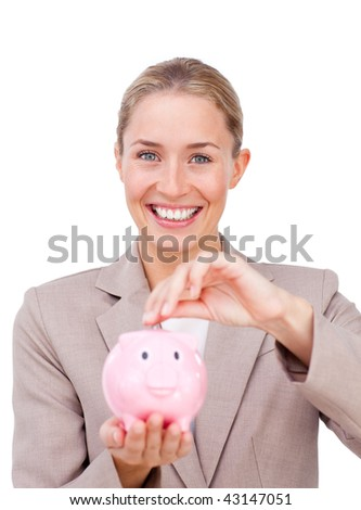 Assertive businesswoman saving money in a piggybank isolated on a white background - stock photo