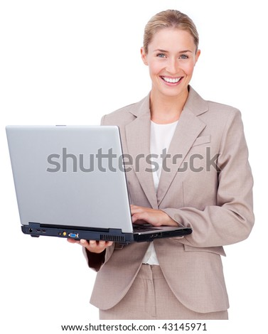 Assertive businesswoman using a laptop against a white background