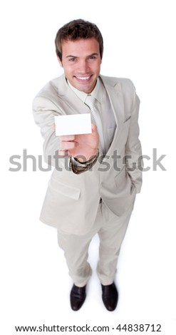 Assertive caucasian businessman holding a white card against a white background - stock photo