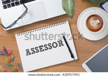 ASSESSOR Tablet with blank black screen and coffee cup - stock photo