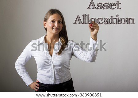 Asset Allocation - Beautiful girl writing on transparent surface - horizontal image