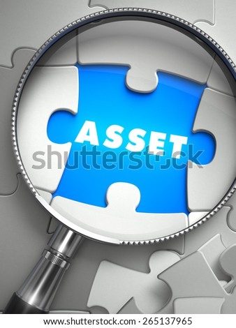 Asset - Word on the Place of Missing Puzzle Piece through Magnifier. Selective Focus. - stock photo
