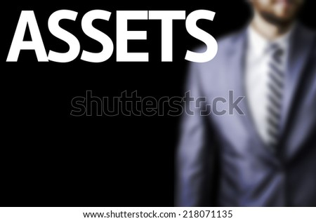 Assets written on a board with a business man on background - stock photo