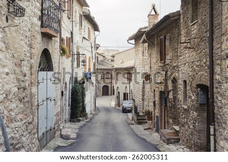 ASSISI, ITALY - JANUARY 23, 2010: View of street in Assisi. Assisi is a town in Perugia in Umbria region, Italy. it is famous for the birth place of St. Francis. - stock photo