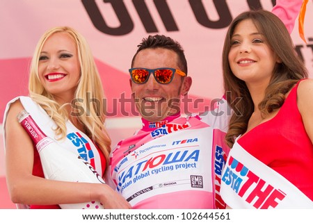 ASSISI, PERUGIA, ITALY - MAY 15: Joaquin Rodriguez, Team Katusha, celebrating the 1st position on general ranking after the 10th stage of 2012 Giro d'Italia on May 15, 2012 in Assisi, Perugia, Italy - stock photo