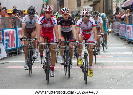 ASSISI, PERUGIA, ITALY - MAY 15: Some cyclists at the end of the 10th stage of 2012 Giro d'Italia on May 15, 2012 in Assisi, Perugia, Italy - stock photo
