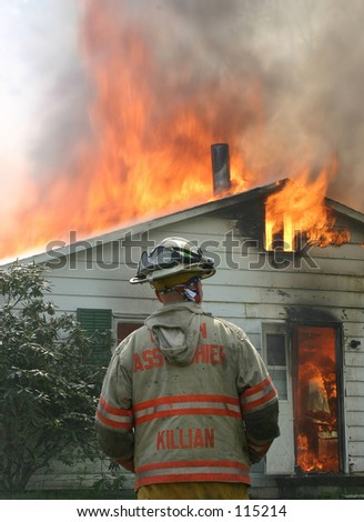 Assistance Fire Chief overlooking fire