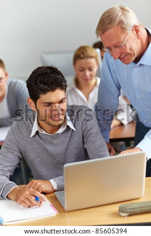 Assistance for student from teacher in university - stock photo