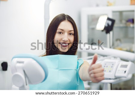 Assistant dentist and the patient in the clinic. - stock photo