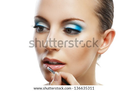 Assistant lipstick beautiful young woman close up, isolated on white background. - stock photo