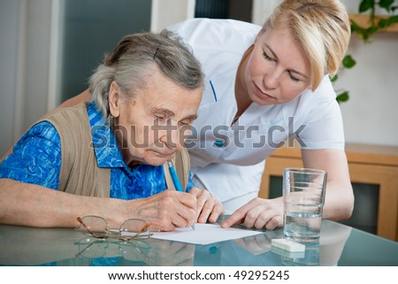 Assisting a senior woman by nurse at home.