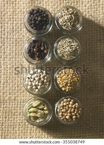 assort spices,cardamon,peppercorn, clove, black pepper,cumin,rosemary,fenugreek and coriander - stock photo
