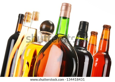 Assorted alcoholic beverages isolated on white - stock photo