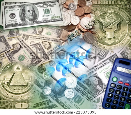 Assorted American currency, abacus and calculator - stock photo