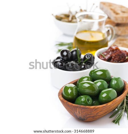 assorted antipasti - olives, pickles, olive oil, fresh rosemary and ciabatta, isolated on white - stock photo