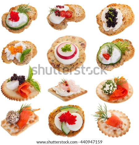 Assorted appetizers on a white background - stock photo