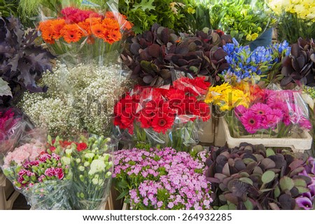 Assorted arrangement of cut flowers in a market stall - stock photo