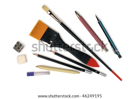 Assorted Art Tools. Brushes and Pencils. Isolated over white background. - stock photo