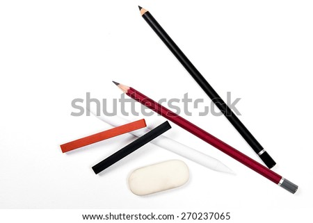 Assorted Art Tools. Pencils, eraser, stamp, chalk of sanguine and charcoal. Isolated over white background. - stock photo